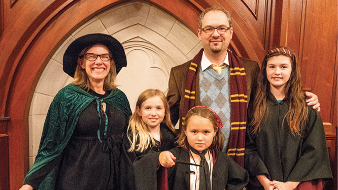 Professor Sarah Igo (left) gets into the spirit of the evening with her husband, Ole Molvig, assistant professor of history and of communication of science and technology, and their children, Eleanor (12), Greta (10) and Hattie (8).