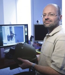 Akos Ledeczi showing his design for a shooter location system installed into a combat helmet. (Vanderbilt University / Steve Green)