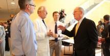 U.S. Sen. Lamar Alexander, right, talks with Vanderbilt's Thomas Talbot, M.D., MPH, right, William Schaffner, M.D., and James Crowe Jr., M.D., at Vanderbilt on Wednesday.