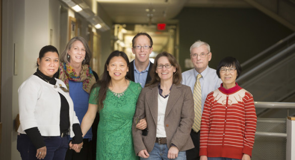 Researchers who helped uncover a new genetic clue to Angelman syndrome include, from left, Janice Williams, Ph.D., Terry Jo Bichell, Ph.D., Jing-Qiong Kang, M.D., Ph.D., Ryan Delahanty, Ph.D., Kelli Boyd, D.V.M., Ph.D., Robert Macdonald, M.D., Ph.D., and Wangzhen Shen. (photo by Susan Urmy)