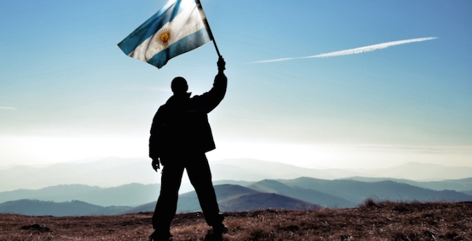 Man waving Argentine flag