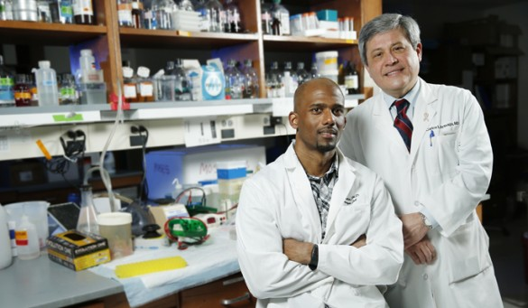 A study by Neil Bhola, Ph.D., left, Carlos Arteaga, M.D., and colleagues suggests that drugs that block a specific signaling pathway in cancer cells enhance the effect of chemotherapy and may prevent recurrences of treatment-resistant triple negative breast cancer. (photo by John Russell)