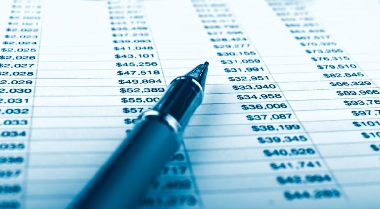 balance sheet with pen