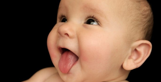 baby sticking out tongue