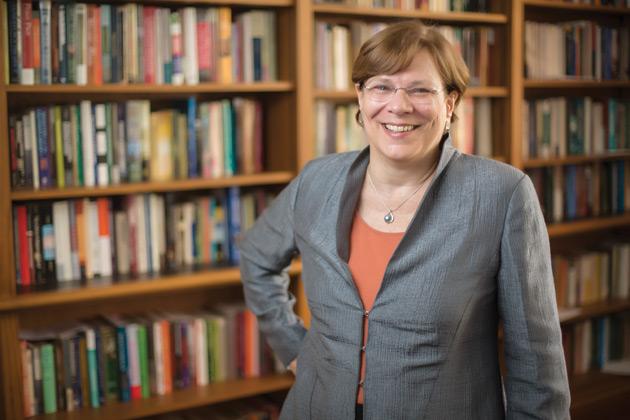 History Professor Lauren Benton staning in front of bookcase