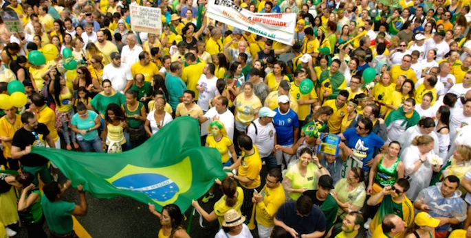 protestors waving brazilian flags