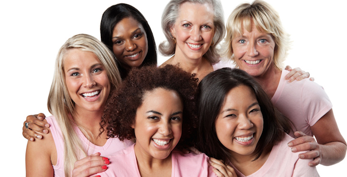 Diverse group of women wearing pink representing breast cancer survival