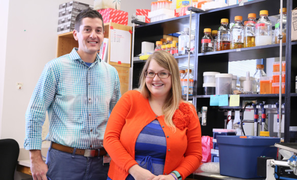 Michael Noto, M.D., Ph.D., and graduate student Jessica Moore participated in research studies showing that two bacterial pathogens cooperate with each other to co-infect the lungs of patients with cystic fibrosis. (photo by Anne Rayner)