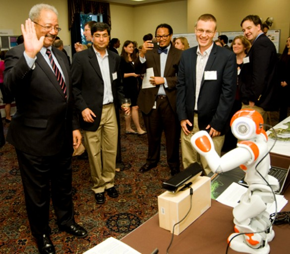 Congressman waves at robot, who waves back