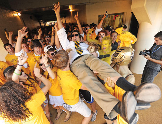 Chancellor Zeppos and students get carried away with school spirit before a football game. (John Russell/Vanderbilt).