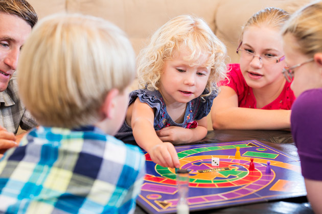 Children playing a board game. (iStockphoto)