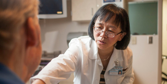 Jie Deng, Ph.D., R.N., is testing a self-care program for head and neck cancer survivors diagnosed with secondary lymphedema and fibrosis (LEF). (photo by Daniel Dubois)
