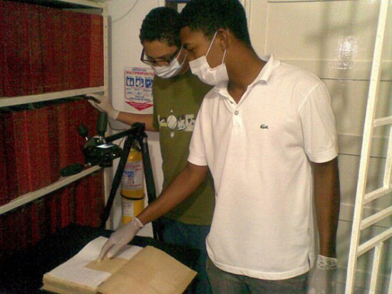Two students work on digitizing slave records in Colombia. (Vanderbilt/ESSSS)
