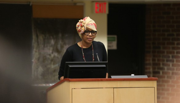 Vanderbilt University School of Medicine student Efi Akam reads a poem at Wednesday's Memorial Service for Recent Victims of Violence in America and the World. (photo by John Russell)