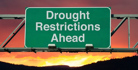 highway sign reading 'drought restrictions ahead'
