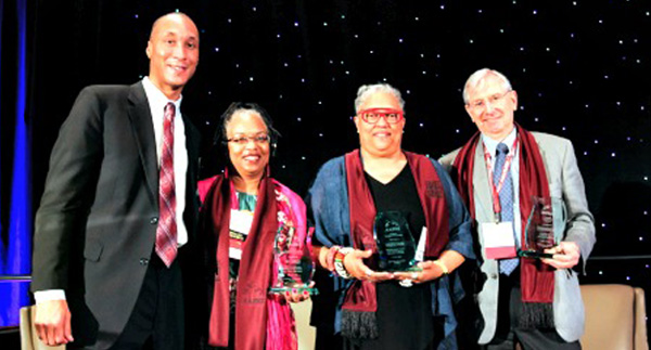 L-r: James Wadley, board member, American Association of Blacks in Higher Education, with this year's winners: Iris L. Outlaw, Exemplary Award for Public Service; Emilie M. Townes, Pacesetter Award; and John von Knorring, Advocacy Award. (courtesy of AABHE)