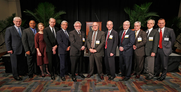 L-r: Provost and Vice Chancellor for Academic Affairs Richard McCarty, Kevin B. Johnson, Celia S. Applegate, David G. Blackbourn, Sergio Fazio, Tony K. Stewart, Haydar A. Frangoul, William O. Cooper, R. Jay Turner, Steven A. Webber, MacRae F. Linton and Vice Chancellor for Health Affairs and Dean of the School of Medicine Jeff Balser. (Vanderbilt University)