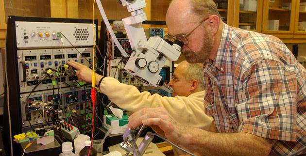 Ford Ebner (foreground), professor of psychology, emeritus, in the animal lab in Wilson Hall. (Vanderbilt University)
