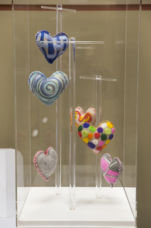 """The """"Heart to Hold""""display case featuring designs by artist Christopher Prinz is in the Vanderbilt-Ingram Cancer Center lobby. (photo by Joe Howell)"""