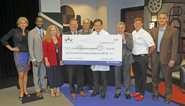 At Monday's event, Hyundai Hope on Wheels representatives from Hyundai Motor America and local Hyundai dealerships presented Richard Ho, M.D., fourth from right, a grant award to further pediatric cancer research. (photo by Steve Green)