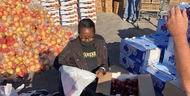 Vanderbilt community members work the OneGenAway food distribution event