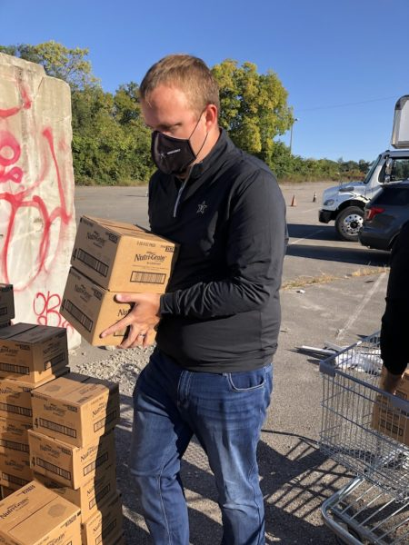 Daniel Culbreath, assistant vice chancellor for state government relations, assists with food distribution efforts during Saturday's event