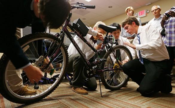 Students working on bike