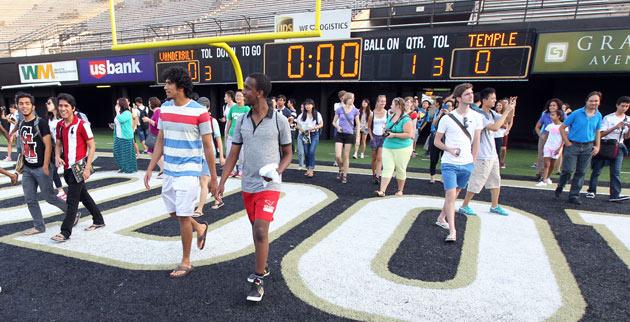"Vanderbilt international students and scholars tour Dudley Field and Vanderbilt Stadium at part of ""Football 101."" (Steve Green/Vanderbilt)"