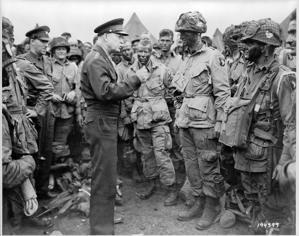 Dwight Eisenhower surrounded by troops