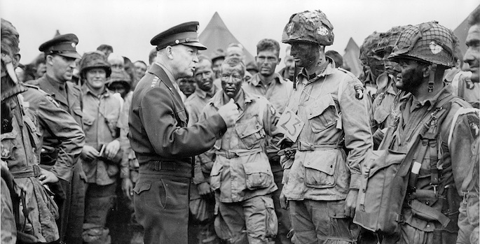 Eisenhower surrounded by troops