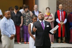 James Dennis, MDiv'16, was among students, faculty and staff taking part in a vigil outside Benton Chapel in 2014 in response to the racial violence of Ferguson and other events that summer. (John Russell/Vanderbilt University)