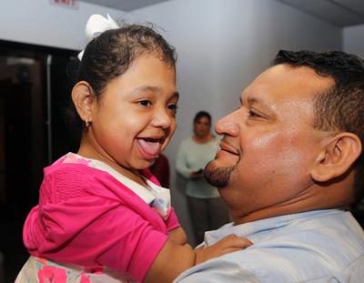 Rare bone disorder patient Janelly Martinez-Amador hugs her father, Salvador Martinez, during a follow-up visit to Monroe Carell Jr. Children's Hospital at Vanderbilt. (photo by Steve Green)