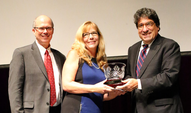 Chancellor Nicholas S. Zeppos (right) recognizes Commodore Award winner Judy Brandon (center) at the Employee Service Celebration Sept. 29, along with Associate Provost and Dean of Students Mark Bandas (left).