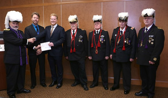 Alex and Anthony with a number of men in masonic uniforms
