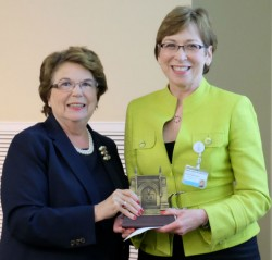 School of Nursing Dean Linda Norman (left) surprised Marilyn Dubree, executive chief nursing officer of Vanderbilt University Medical Center, with the Dean's 2016 Award for Outstanding Service to Faculty and Students. (Vanderbilt University)