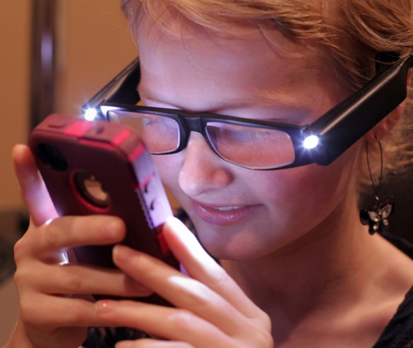With the help of her new Low Vision Readers, Vanderbilt Eye Institute patient Alexis London can once again perform difficult tasks such as texting and reading. (photo by Steve Green)