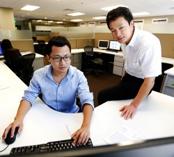 Luo and Song at computer