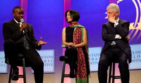 From left, Milton Ochieng, co-founder of the Lwala Community Alliance, Reeta Roy, president and CEO of the MasterCard Foundation, and President Bill Clinton at the Clinton Global Initiative 2011 Annual Meeting in New York City.
