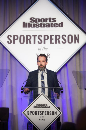 Mark Bechtel at podium announces SI Sportsperson of the Year