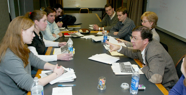 Michael Bess (far right), Chancellor's Professor of History, consults with junior faculty during a Center for teaching-sponsored Teaching Visit. (image courtesy Center for Teaching)