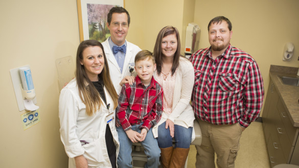Liver transplant patient Erin Morris, second from right, with her son Corbin, husband Allen, right, Roman Perri, M.D., and Heather O'Dell, ANP-BC, at a recent follow-up appointment. (photo by Susan Urmy)