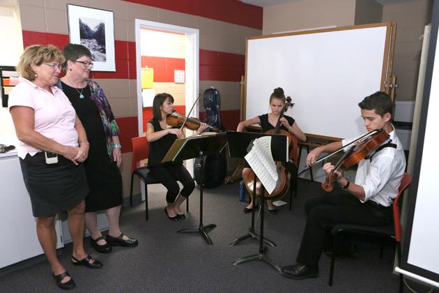 L-r: Myra Jackson Blair scholars Maggie Kasinger, violin; Caroline Bender, cello; and Sam Bender, viola, perform at the Vanderbilt Home Care 30th anniversary celebration.