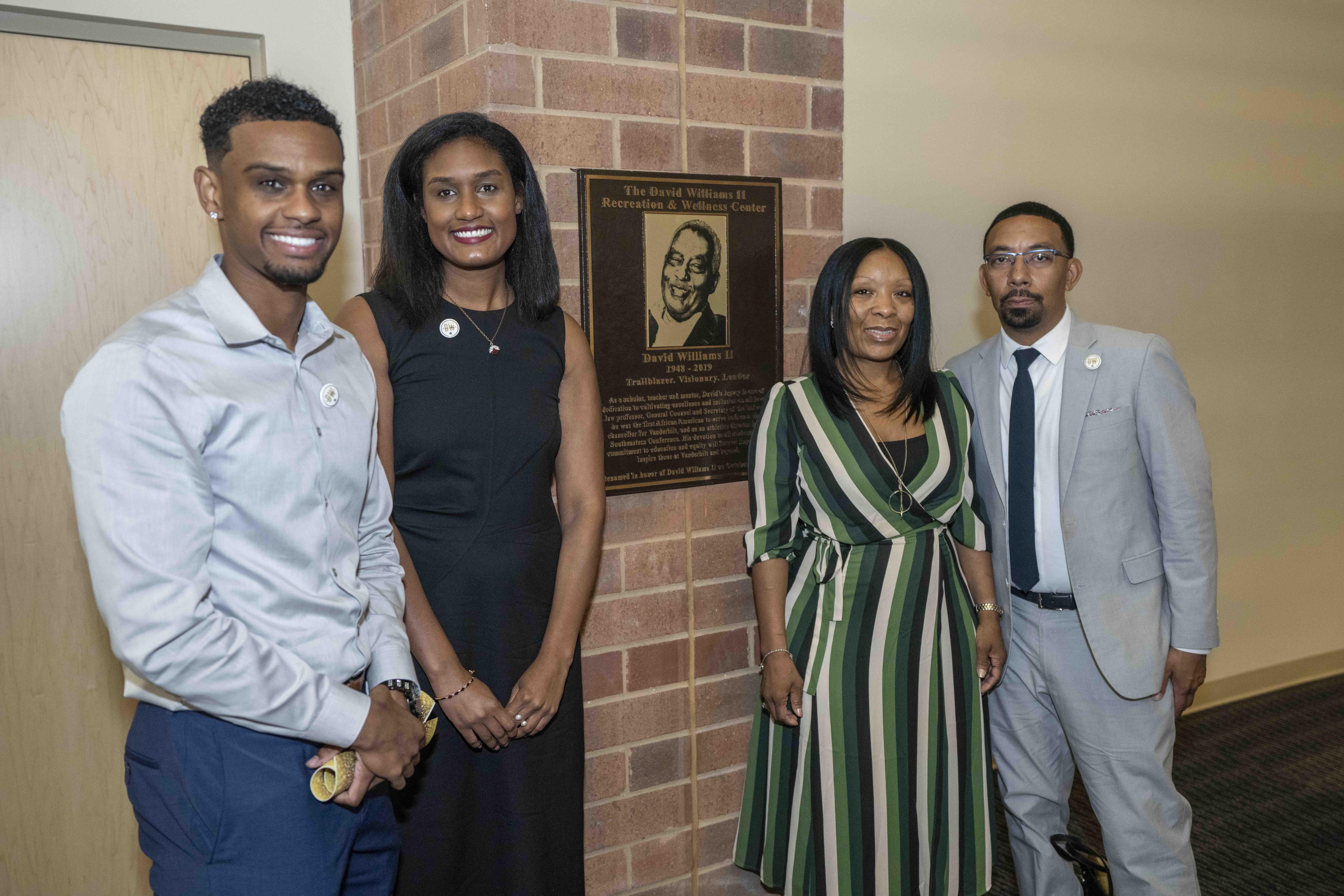 David Williams' children stand next to a new plaque honoring Vanderbilt's late former athletics director and vice chancellor. (John Russell/Vanderbilt University)