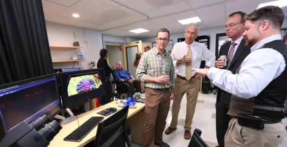 Nikon's Cumberland Dugan, right, describes one of the live-cell imaging systems in the new Vanderbilt Nikon Center of Excellence to, from left, Matthew Tyska, Ph.D., Ian Macara, Ph.D., and Jeff Balser, M.D., Ph.D. (photo by Anne Rayner)