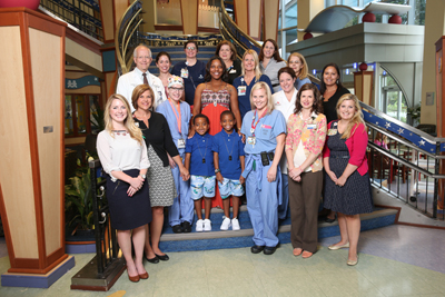 The pediatric liver transplant team gathered for a photo during Antwane Cole Jr.'s recent followup visit. (photo by John Russell)