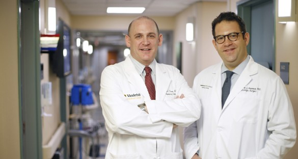 David Penson, M.D., MPH, left, and Matthew Resnick, M.D., are studying the outcomes among prostate cancer patients treated with surgery versus radiotherapy. (photo by John Russell)