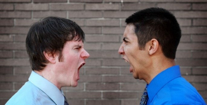 two men shouting at each other
