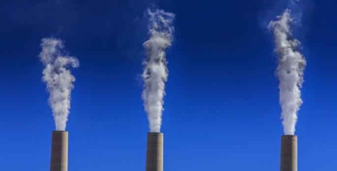 smokestacks pouring smoke into the sky