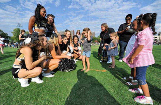 Vanderbilt cheerleaders meet with young fans at Employee Tailgate. (Vanderbilt University)