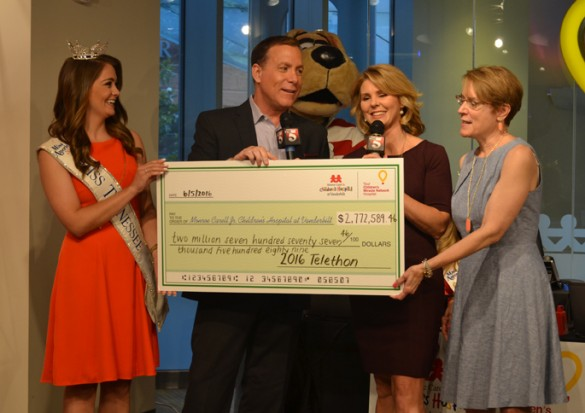 Miss Tennessee Hannah Robison, WTVF News Channel 5 anchors Rhori Johnston and Carrie Sharp along with Meg Rush, M.D., Children's Hospital chief-of-staff, unveil the total raised for the 2016 telethon.